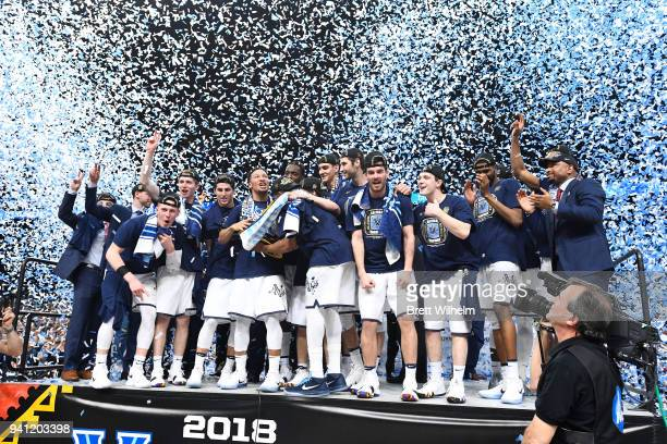 The Villanova Wildcats celebtrate on stage after the 2018 NCAA Photos via Getty Images Men's Final Four National Championship game against the...