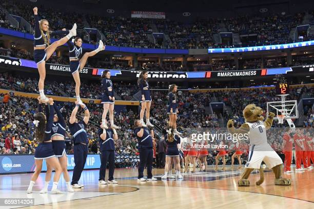 The Villanova Wildcats cheerleaders perform during the Second Round of the NCAA Basketball Tournament against the Wisconsin Badgers at The KeyBank...