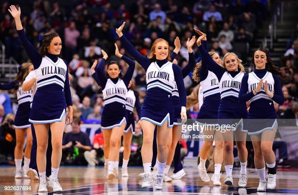 The Villanova Wildcats cheerleaders wave to the crowd during the game against the Radford Highlanders in the the first round of the 2018 NCAA Photos...