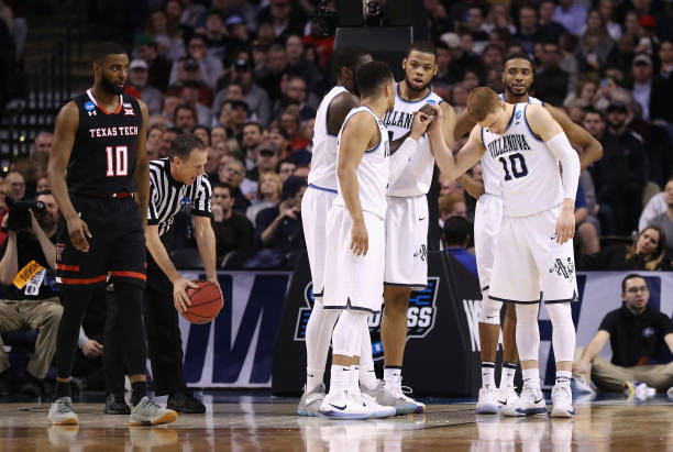 The Villanova Wildcats huddle during the first half against the Texas Tech Red Raiders in the 2018 NCAA Men's Basketball Tournament East Regional at...