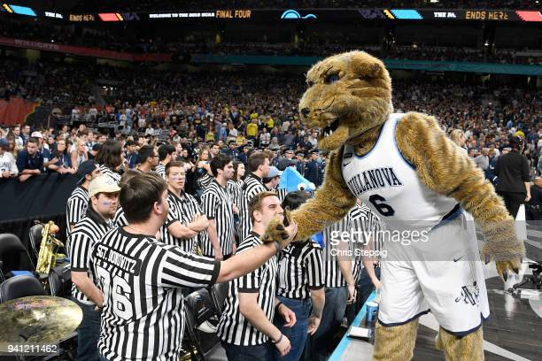 The Villanova Wildcats mascot and the band cheer on their team against the Michigan Wolverines during the first half in the 2018 NCAA Photos via...