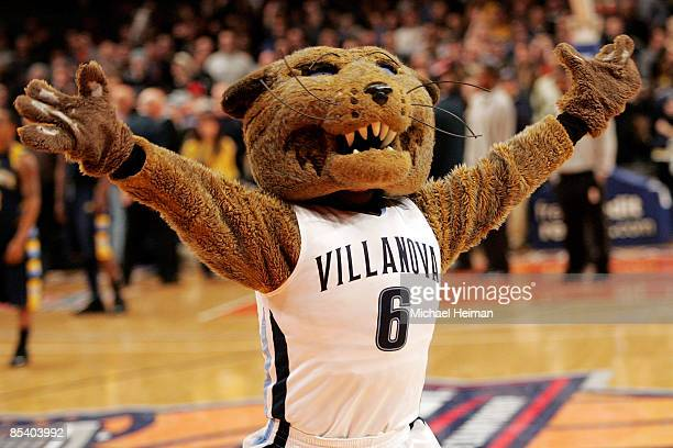 The Villanova Wildcats mascot celebrates after defeating the Marquette Golden Eagles during the second round of the Big East Tournament at Madison...