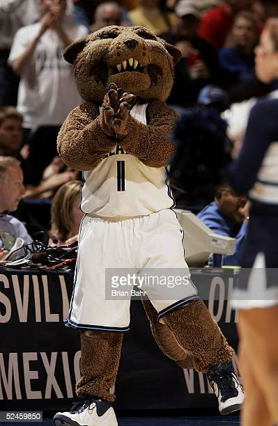 The Villanova Wildcats mascot cheers during a stoppage in time against the Florida Gators in the second round of the NCAA Division I Men's Basketball...