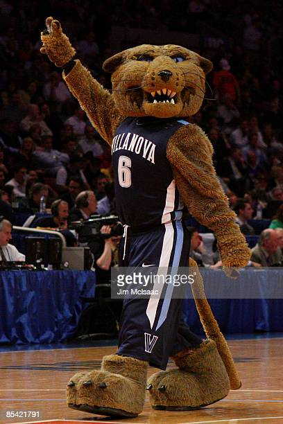 The Villanova Wildcats mascot performs during a timeout against the Louisville Cardinals walks off of the court during the semifinal round of the Big...