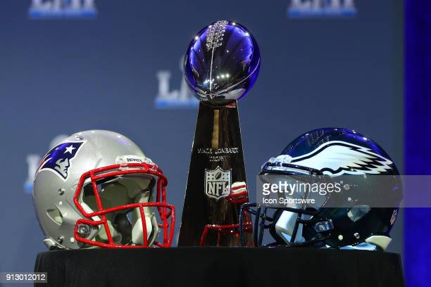 The Vince Lombardi Trophy and the New England Patriots helmet and the Philadelphia Eagles helmet on display at the Commissioners Press Conference on...