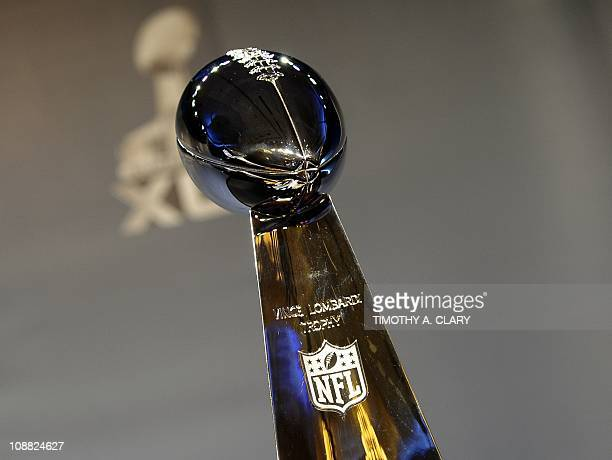 The Vince Lombardi trophy awarded to the winner of the Super Bowl is displayed at the coach's news conference at the Super Bowl XLV Media Center in...