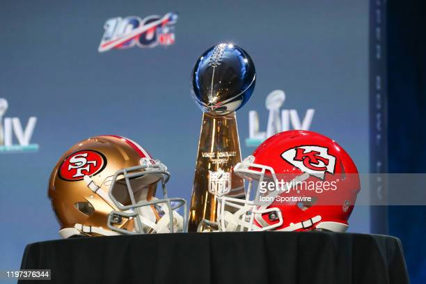 The Vince Lombardi Trophy is displayed before the Commissioners press conference with a San Francisco 49ers and Kansas City Chiefs helmet onn January...