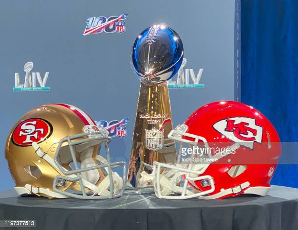 The Vince Lombardi Trophy is displayed before the Commissioners press conference with a San Francisco 49ers and Kansas City Chiefs helmet on January...
