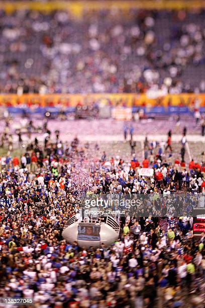 The Vince Lombardi Trophy is presented to the New York Giants after the Giants defeated the Patriots by a score of 2117 in Super Bowl XLVI at Lucas...