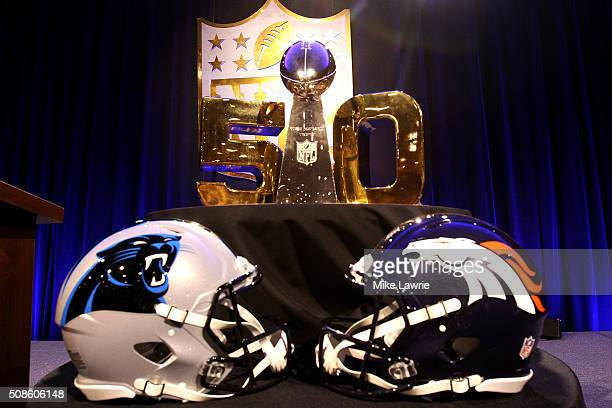 The Vince Lombardi Trophy sits in front of a gold '50' with the helmets of the Carolina Panthers and Denver Broncos before the 2015 Walter Payton Man...