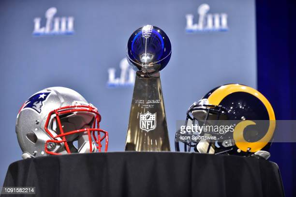 The Vince Lombardi Trophy sits on a table between the New England Patriots and Los Angeles Rams helmets prior to NFL Commissioner Roger Goodell's...