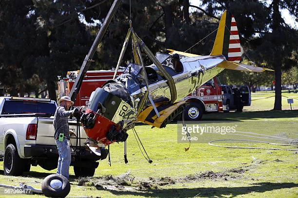 The vintage plane that crashed on the Penmar golf course not far from Santa Monica Municipal Airport is moved Friday, March 6, 2015. Harrison Ford...