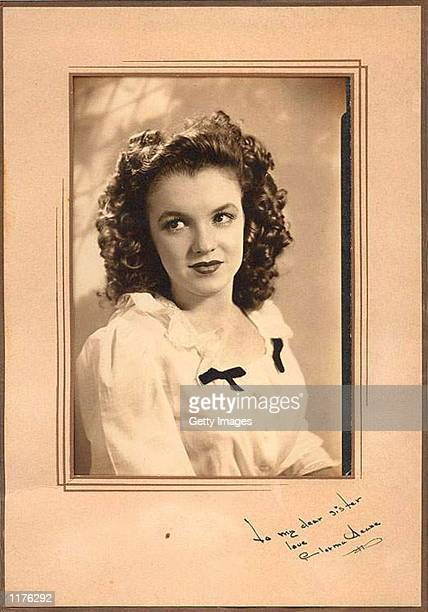 The vintage portrait of Norma Jean Dougherty also known as actress Marilyn Monroe with a rare autograph and dedication To my dear sister is on...