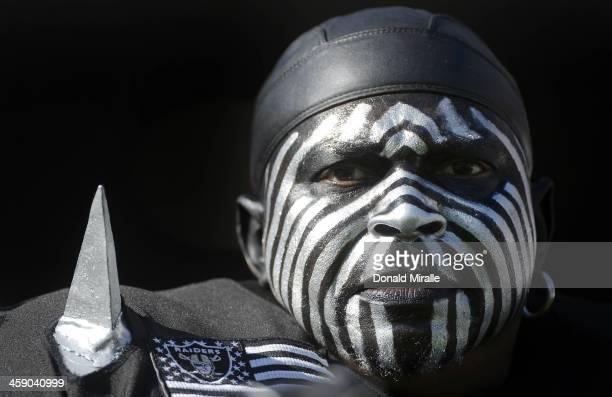 The Violator an Oakland Raiders fan looks on from the stands during a game against the San Diego Chargers on December 22 2013 at Qualcomm Stadium in...