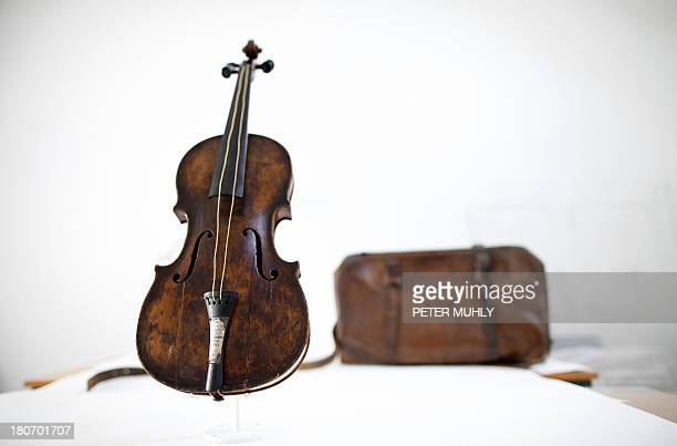 The violin played by bandmaster Wallace Hartley during the final moments before the sinking of the Titanic is displayed with a leather carrying case...