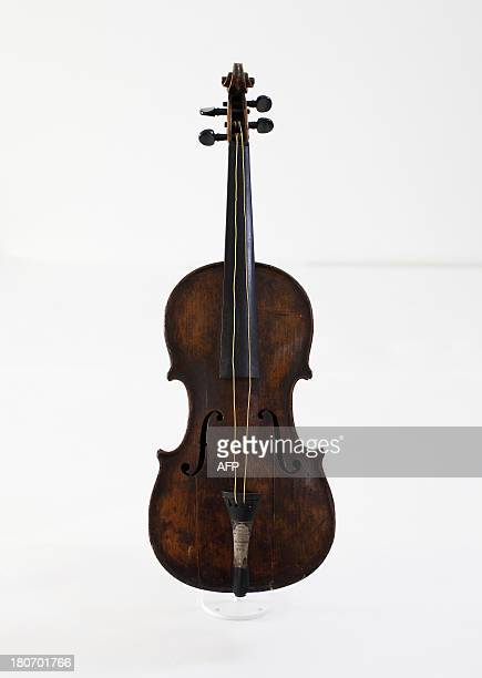The violin played by bandmaster Wallace Hartley during the final moments before the sinking of the Titanic is displayed at a conservation studio in...