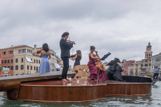 ITA: Violin-Shaped Boat Parades Along Venice's Grand Canal