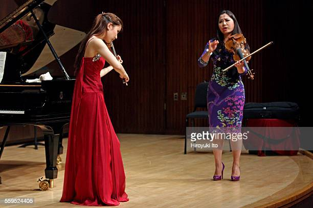 The violinist Sarah Chang teaching master class at the Juilliard School on Tuesday afternoon, March 26, 2015.This image:From left, Angela Wee and...