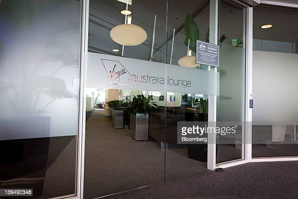 The Virgin Australia Holdings Ltd logo is displayed on the entrance to the airline's lounge at the domestic terminal of Sydney airport in Sydney...