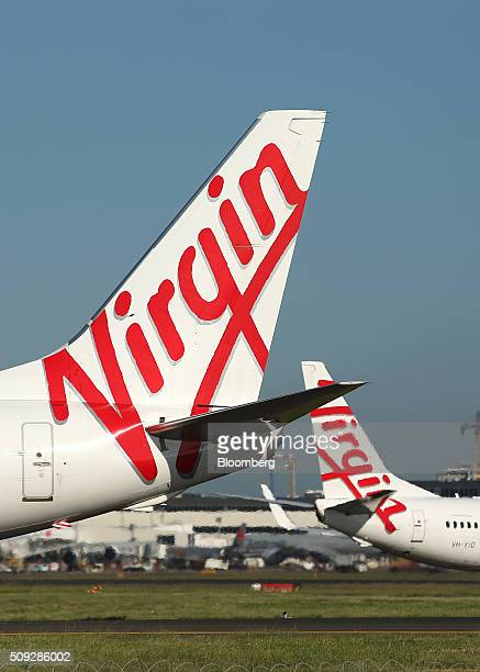 The Virgin Australia Holdings Ltd logo is displayed on the tail of a Boeing Co 737800 aircraft left preparing to take off at Sydney Airport in Sydney...