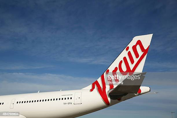 The Virgin Australia Holdings Ltd logo is displayed on the tail of an Airbus SAS A330 aircraft at Sydney Airport in Sydney Australia on Monday Aug 17...