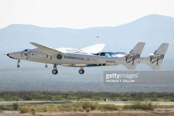 The Virgin Galactic SpaceShipTwo space plane Unity flies at Spaceport America, near Truth and Consequences, New Mexico on July 11, 2021 before travel...