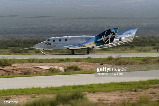 The Virgin Galactic SpaceShipTwo space plane Unity returns to earth after the mothership separated at Spaceport America, near Truth and Consequences,...