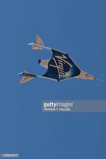 The Virgin Galactic SpaceShipTwo space plane Unity returns to earth after the mothership separates flying way above Spaceport America, near Truth and...