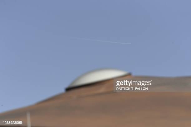 The Virgin Galactic SpaceShipTwo space plane Unity, the mothership and the drop shift are seen above the Spaceport America, near Truth and...