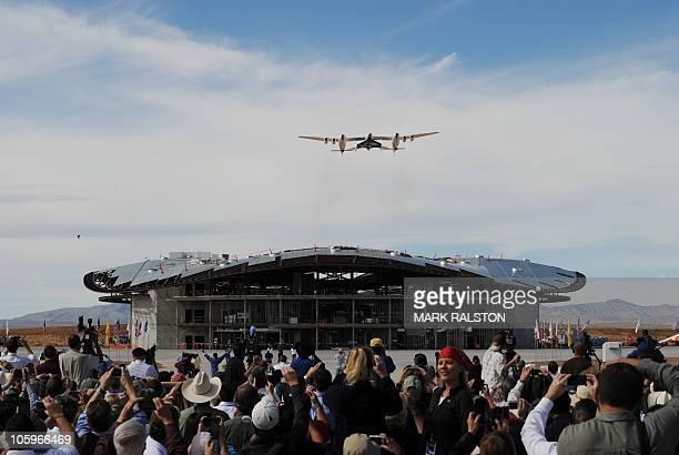 The Virgin Galactic VSS Enterprise spacecraft flies over it's hanger before it's first public landing during the Spaceport America runway dedication...