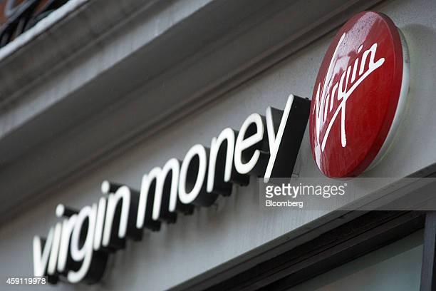 The Virgin logo sits on a sign outside a Virgin Money Holdings Plc bank branch in London, U.K., on Monday, Nov. 17, 2014. Virgin Money, the lender...