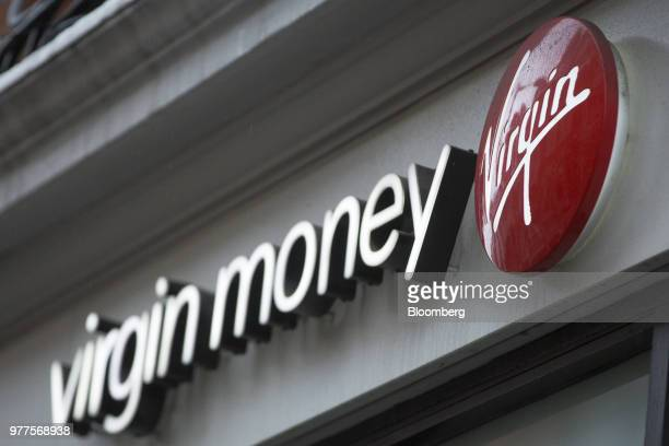 The Virgin logo sits on a sign outside a Virgin Money Holdings Plc bank branch in London UK on Monday Nov 17 2014 CYBG Plc agreed to buy Virgin Money...