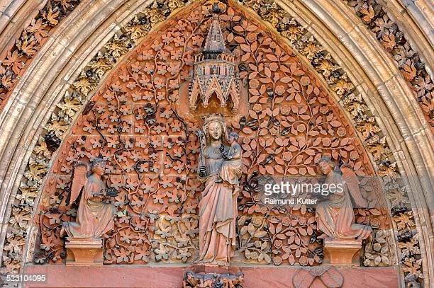 The Virgin Mary with angels in the tympanum of the portal of the Gothic St. Elizabeths Church, Marburg, Hesse, Germany