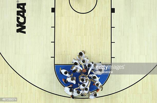 The Virgina Cavaliers huddle during their game against the Michigan State Spartans in the third round of the 2015 NCAA Men's Basketball Tournament at...