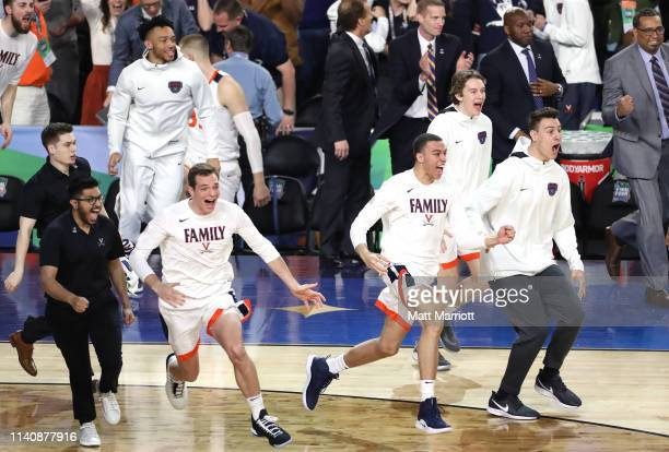 The Virginia bench reacts to winning the semifinal game in the NCAA Men's Final Four at US Bank Stadium on April 06 2019 in Minneapolis Minnesota
