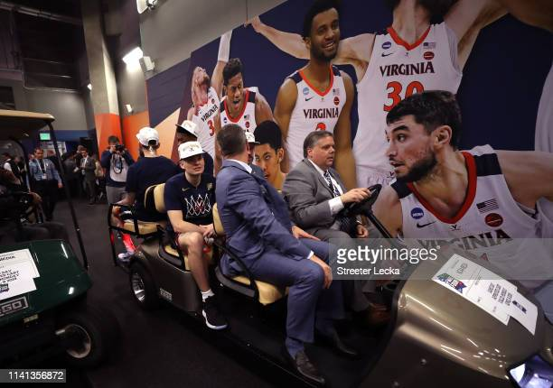 The Virginia Cavaliers are carted through the stadium after their teams 85-77 win over the Texas Tech Red Raiders in the 2019 NCAA men's Final Four...