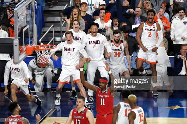 The Virginia Cavaliers bench reacts against the Texas Tech Red Raiders in the second half during the 2019 NCAA men's Final Four National Championship...