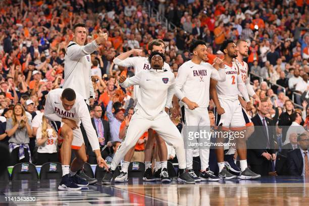 The Virginia Cavaliers bench reacts to a play during the second half of the game against the Texas Tech Red Raiders in the 2019 NCAA Photos via Getty...