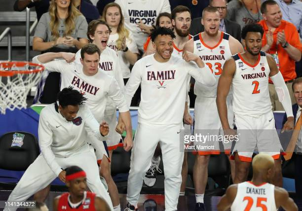 The Virginia Cavaliers bench reacts to a play during the second half of the game against the Texas Tech Red Raiders in the 2019 NCAA men's Final Four...