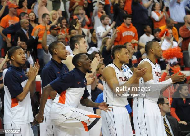 The Virginia Cavaliers celebrate after a three point basket by Virginia Cavaliers guard Joe Harris during the second half of the game between the...