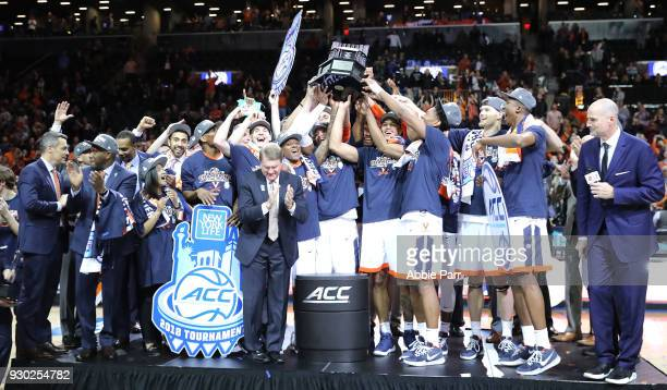 The Virginia Cavaliers celebrate after defeating the North Carolina Tar Heels 7163 during the championship game of the 2018 ACC Men's Basketball...