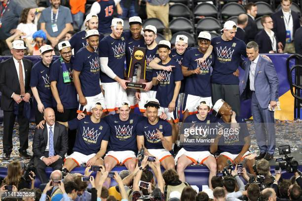 The Virginia Cavaliers celebrate after defeating the Texas Tech Red Raiders in the 2019 NCAA Photos via Getty Images men's Final Four National...