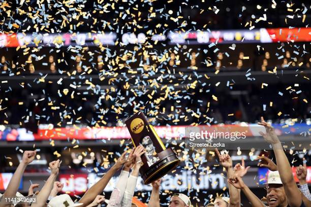 The Virginia Cavaliers celebrate with the NCAA trophy after their teams 85-77 win over the Texas Tech Red Raiders to win the the 2019 NCAA men's...