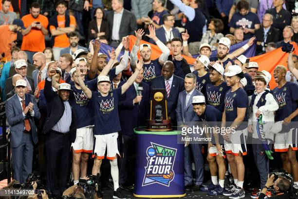 The Virginia Cavaliers celebrate with the trophy after defeating the Texas Tech Red Raiders in the 2019 NCAA Photos via Getty Images men's Final Four...