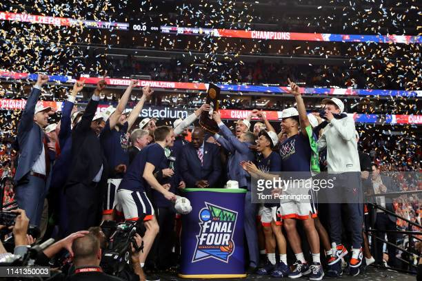 The Virginia Cavaliers celebrate with the trophy after their 8577 win over the Texas Tech Red Raiders during the 2019 NCAA men's Final Four National...