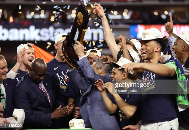 The Virginia Cavaliers celebrate with the trophy after their 85-77 win over the Texas Tech Red Raiders during the 2019 NCAA men's Final Four National...