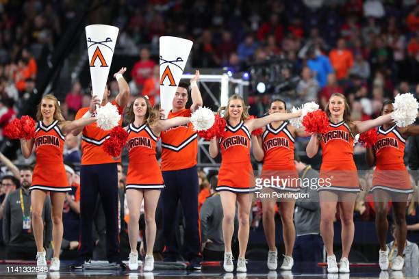 The Virginia Cavaliers cheerleaders perform prior to the 2019 NCAA men's Final Four National Championship game against the Texas Tech Red Raiders at...