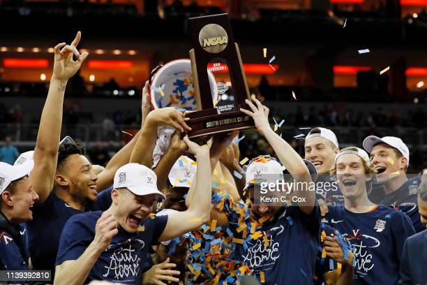 The Virginia Cavaliers raise the trophy after defeating the Purdue Boilermakers 8075 in overtime of the 2019 NCAA Men's Basketball Tournament South...