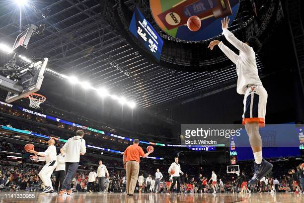 The Virginia Cavaliers warm up during the 2019 NCAA men's Final Four National Championship game at US Bank Stadium on April 08 2019 in Minneapolis...
