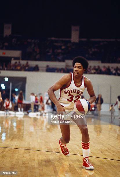 The Virginia Squires forward Julius Erving dribbles with the ball during a college game